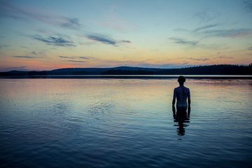 Man standing in lake, Finland