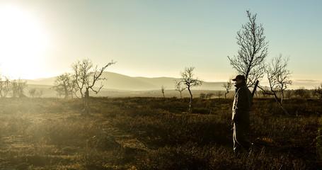 Male hunter with gun, Finland