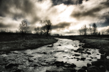 River and stormy sky, Finland, monochrome