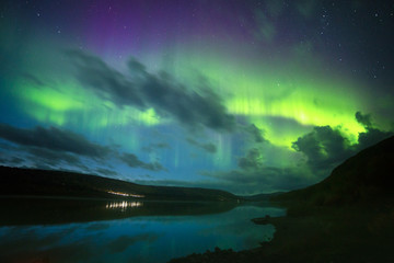 Northern lights over lake, Norway