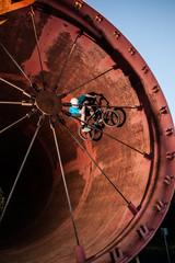 Male stunt bike rider in cylinder