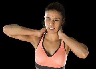 hispanic fitness woman touching and grabbing her neck and upper back suffering cervical pain