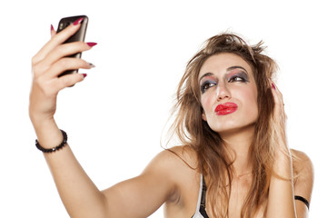 young beautiful woman , bad makeup and selfies