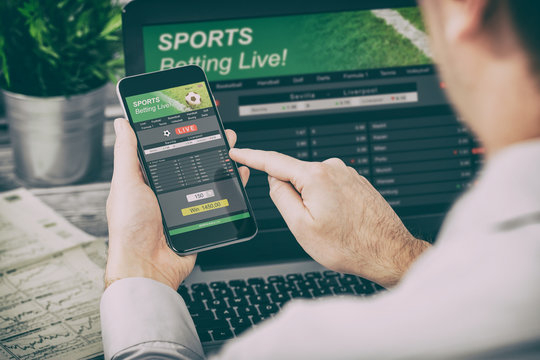 betting bet sport phone gamble laptop concept
