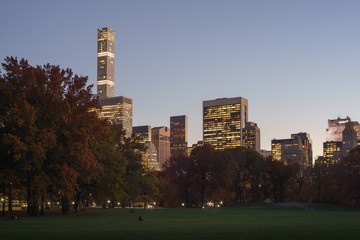 View of buildings along Central park 59th Street at twilight