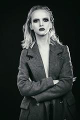 Sexy blond in a coat. fashion Photo