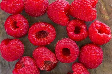 Freshly rinsed red raspberries on stone