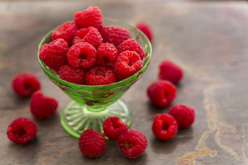 Red Raspberries in a green depression glass