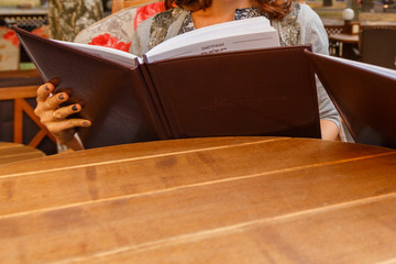 Women looking menu in cafe