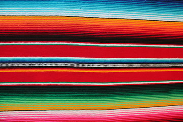 mexican poncho background cinco de mayo serape Mexico blanket fiesta pattern fabric textile background with stripes lines rug copy space pattern  stock photo photograph image picture