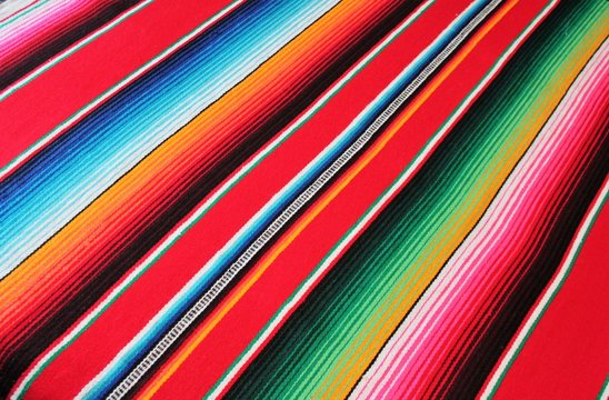 poncho mexican Poncho background serape Mexican Mexico cinco de mayo blanket fiesta with stripes diagonal copy space blanket pattern backdrop stock photo photograph picture image