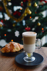 Christmas or New Year pastries,Croissant with a warming drink,coffee.Winter Holidays Concept.Holiday Decorations. top view.Vintage style. selective focus.