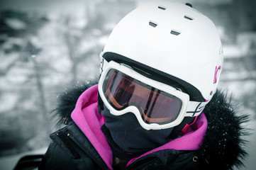 Winter Snowboarder close up in a helmet and glasses
