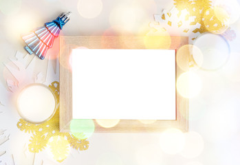 Empty photo frame with christmas tree toy, white and gold snowfl