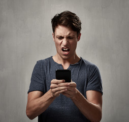 disappointed man with cell phone.