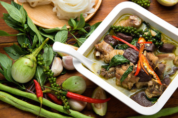 Thai food chicken green curry on wooden table background. top view