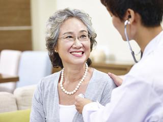 senior asian woman having a physical check