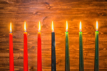 Kwanzaa festival concept with seven candles red, black and green