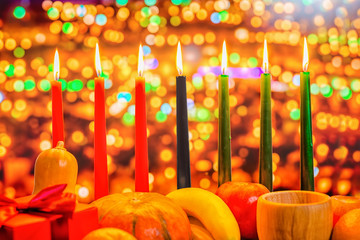 Kwanzaa celebration concept with seven candles red, black and gr