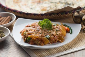 oqda , fried potatoes with meat popular arab food