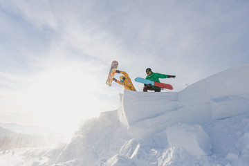 Funny snowboarders on the mountain