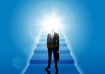 光へと続く階段とビジネスマンのシルエット