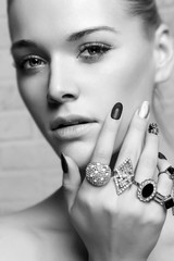 beauty face.woman's hands with jewelry rings.beauty and fashion portrait