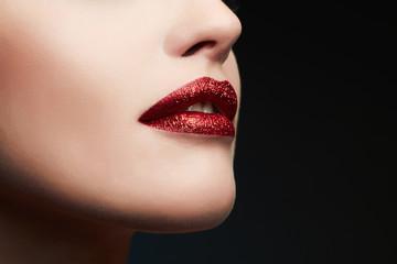 Sexy Lips. Beauty Red Lips Makeup Detail. Beautiful Sensual woman. glitter lips,lipstick or Lip gloss