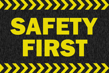 SAFETY FIRST sign on black background Wall mural
