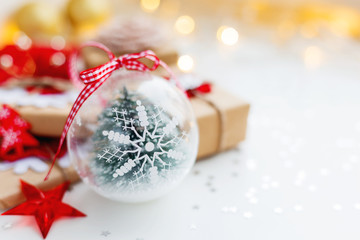 Christmas and New Year background with snowflake decorative ball, presents and decorations for Christmas tree. Holiday background with stars confetti and light bulbs. Place for text.