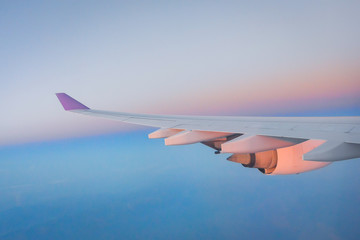 Adventure, travel, transport concept. View from plane window at