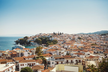 Look from above at beautiful Greek city in the rays of summer li