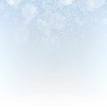 Winter abstract background with falling snowflakes and sparkles.