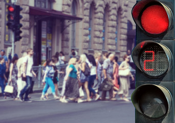 Fotomurales - Images of red traffic lights and people.