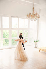 first wedding danc.wedding couple dances on the studio. Wedding day. Happy young bride and groom on their wedding day. Wedding couple - new family. Wedding dress.