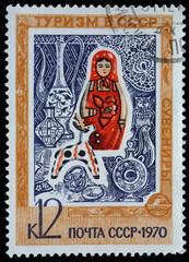 "USSR - CIRCA 1970: Postage stamp of the series ""Tourism in the USSR"" with a picture of matryoshka doll and other souvenirs, printed in USSR, circa 1970"