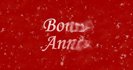 "Happy New Year text in French ""Bonne ann?e"" turns to dust from bottom on red background"