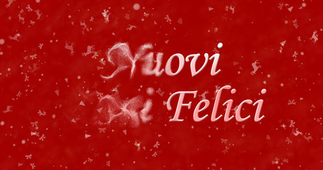 "Happy New Year text in Italian ""Nuovi anni felici"" turns to dust from bottom on red background"