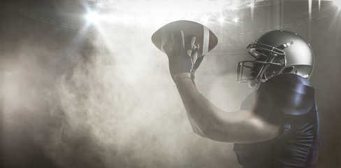 Composite image of american football player catching ball