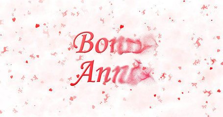 "Happy New Year text in French ""Bonne ann?e"" turns to dust from bottom on white background"