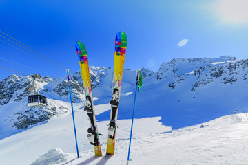 Fototapete - Ski winter season - mountains, cable car and ski equipments on s