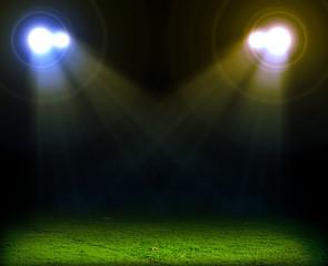 Green soccer field, bright spotlights