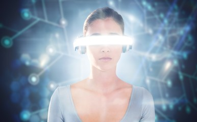 Composite image of young woman using virtual video glasses