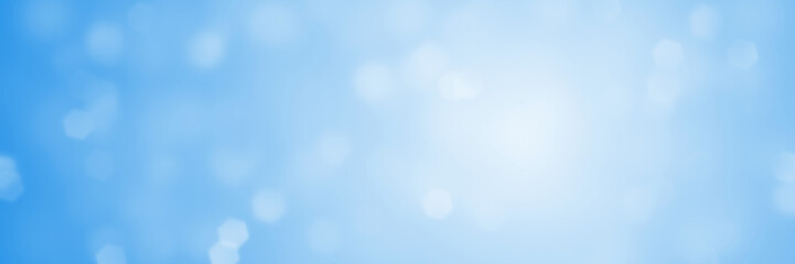 hexagon bokeh banner background in shades of soft blue