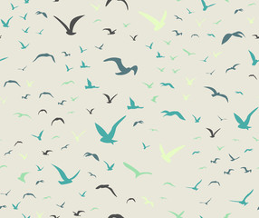 Blue colored seagulls silhouettes as seamless pattern