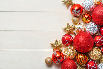 Christmas background with decorations on wooden background. Top