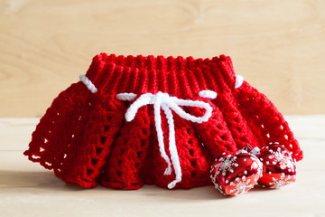 Knitting. Christmas skirt, tree toy,  close up
