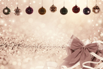 Christmas background with christmas ball and snow on glitter bok