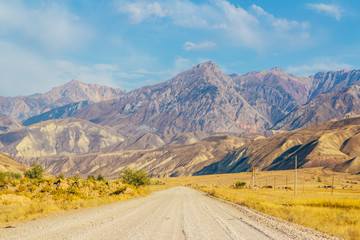 Keuken foto achterwand Nieuw Zeeland The road and magnificent view of colourful mountain landscape in the centre of Kyrgyzstan, Naryn province right on the border with Jalal-abad province. Central Asia