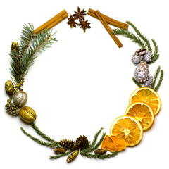 Christmas round frame made of natural winter things, fir tree branch, golden and silver pine cones, walnuts, cinnamon. star anise, dry oranges fruit. Flat lay. New Year`s background isolated on white.